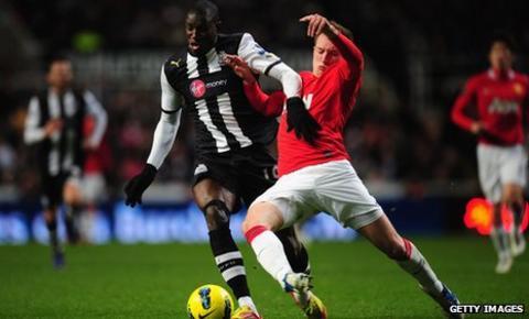 Demba Ba, left, takes on Phil Jones