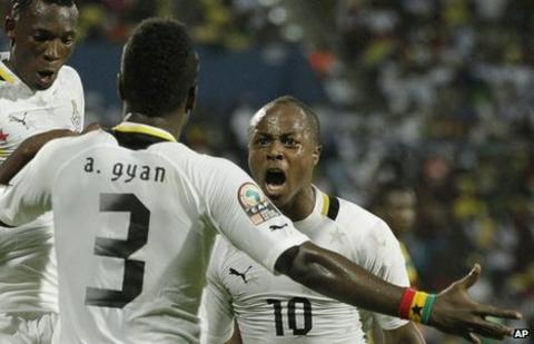 Dede Ayew and Asamoah Gyan celebrate scoring against Mali