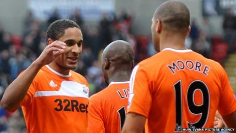 Ashley Williams celebrates with Luke Moore after the striker had put Swansea ahead against Bolton Wanderers