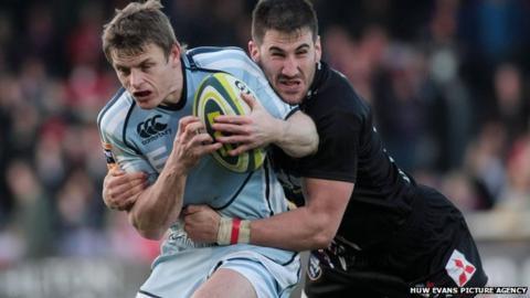 Ben Blair is tackled by Gloucester's Matt Cox