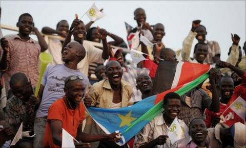 South Sudanese fans cheer their national team's first match in a friendly against Kenya side Tusker to celebrate independence last July