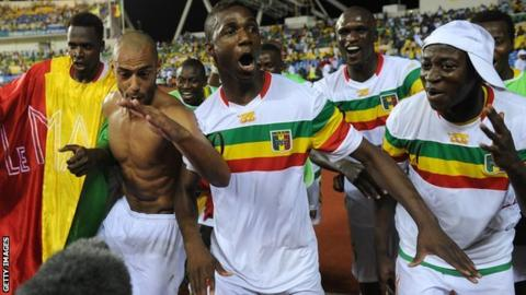 Mali players celebrate their penalty shoot-out win against Gabon
