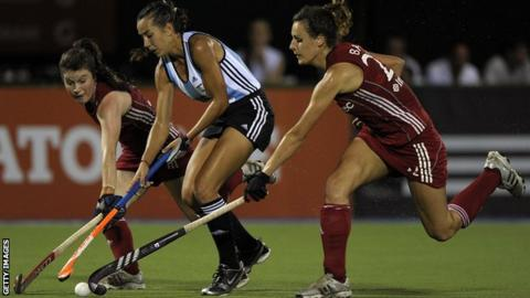 Argentina's Maria Sruoga vies for the ball with England's Laura Unsworth (left) and Ashleigh Ball