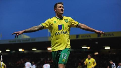 Norwich City winger Anthony Pilkington celebrates scoring at Carrow Road