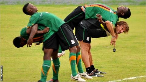 Zambia coach Herve Renard (bottom right) puts his players through training on Monday