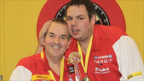 Phil Taylor and Adrian Lewis celebrate their World Cup victory in Hamburg on Sunday