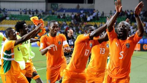 Ivory Coast players celebrate their win over Mali