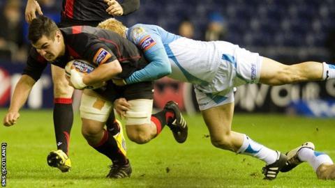 Edinburgh's Stuart McInally is tackled by Ospreys' Hanno Dirksen (right)