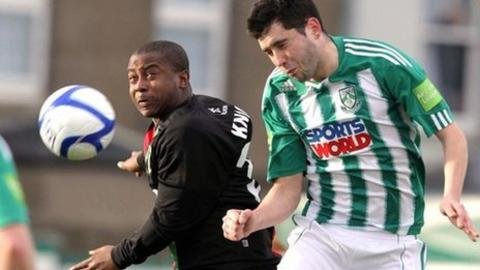 Leon Best challenges Dave Webster for the ball in the first leg at Bray