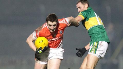 Armagh midfielder Malachy Machin is challenged by Kerry's Sean O'Sullivan
