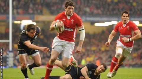 Wales wing Alex Cuthbert breaks through against Scotland for his first Test try