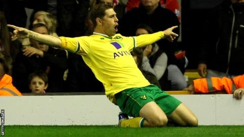 Grant Holt celebrates a goal for Norwich City