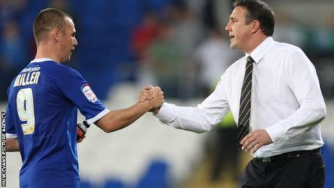 Malky Mackay shakes the hand of Cardiff striker Kenny Miller