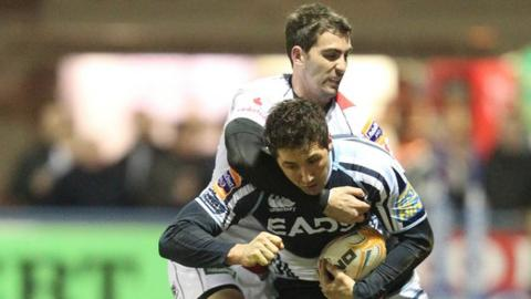 Gavin Henson is tackled by Ruan Pienaar