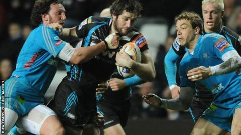Aironi's Mauro Bergamasco tackles Ospreys centre Andrew Bishop