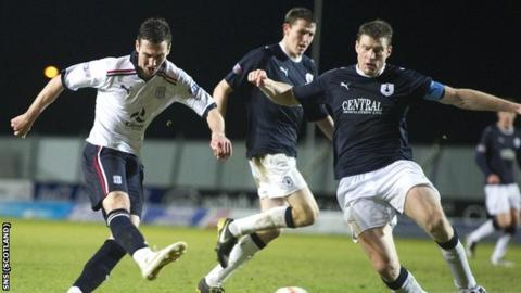 Dundee's Carl Finnigan scores a late equaliser