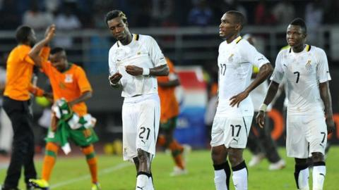 Ghana players show their disappointment after losing the Nations Cup semi final to Zambia