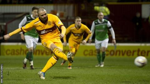 Michael Higdon scores a penalty for Motherwell against Hibernian