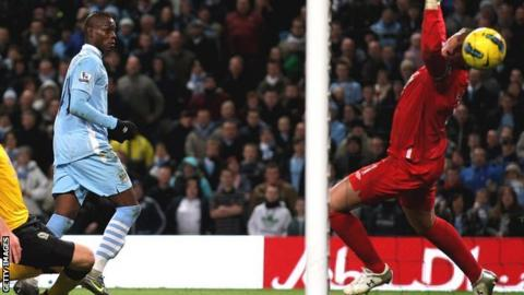 Mario Balotelli (right) scores for Manchester City