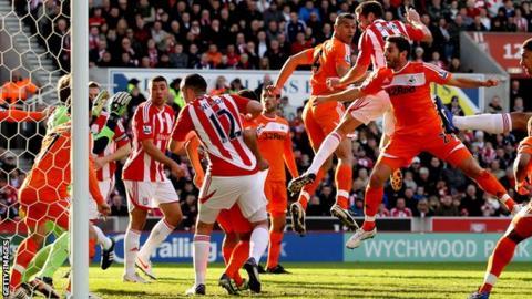 Stoke City's Matthew Upson opens the scoring against Swansea City
