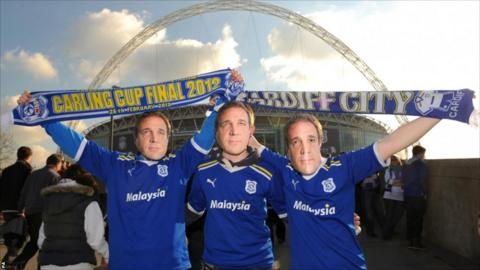 Cardiff City fans wearing masks of Cardiff City Manager Malky Mackay outside Wembley Stadium, before the Carling Cup Final at Wembley Stadium