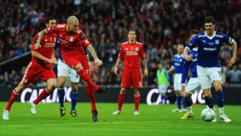 Martin Skrtel of Liverpool scores during the Carling Cup final match