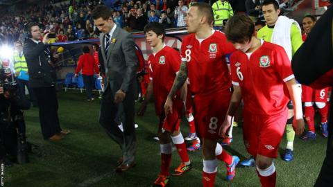 Gary Speed's sons Ed and Tom led the Wales team out against Costa Rica in Cardiff with family friend and captain for the night Craig Bellamy and regular skipper Aaron Ramsey, who is injured