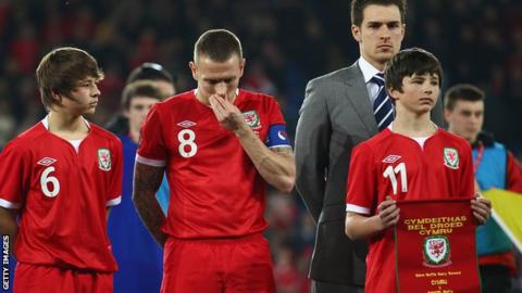 Wales captain Craig Bellamy flanked by Gary Speed's sons Ed and Tom, with Aaron Ramsey standing behind