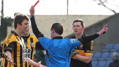 Stephen Kernan protests his innocence after being sent off by referee David Coldick in the All-Ireland semi-final