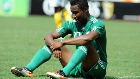 John Mikel Obi reacts to Nigeria's failure to reach the 2012 Africa Cup of Nations following a 2-2 draw against Guinea in Abuja