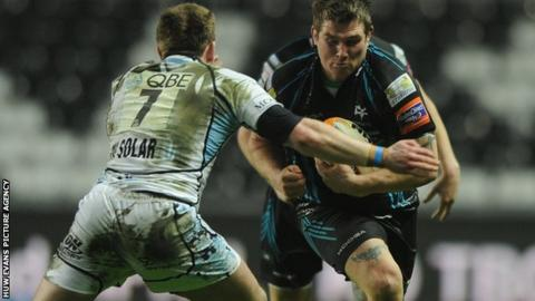 Ospreys hooker Richard Hibbard takes on Glasgow's Chris Fusaro