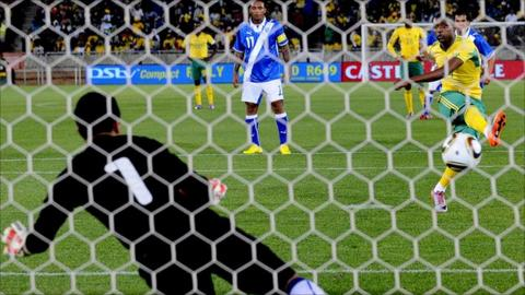 Katlego Mphela scores one of three penalties awarded in South Africa's 5-0 win over Guatemala