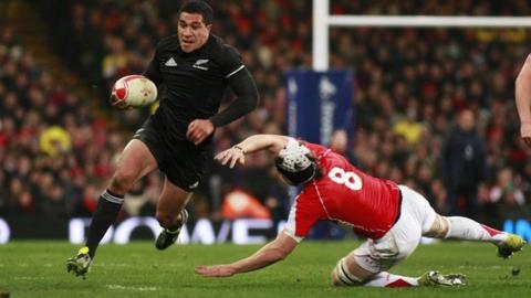 New Zealand's Mils Muliaina leaves Wales' Ryan Jones for dead in the 2010 clash in Cardiff
