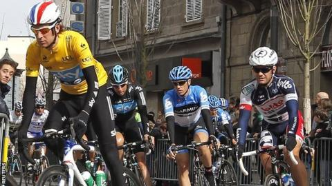 Bradley Wiggins (left) pictured in the leader's yellow jersey during the fourth stage