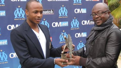 Dede Ayew with the BBC African Footballer of the Year tropy that he collected from his father Abedi
