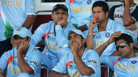 Rahul Dravid (far left) and India's players look on dejectedly as they go out of the 2007 World Cup