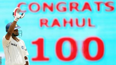 Rahul Dravid acknowledges a message on a screen congratulating him for reaching 100 against South Africa