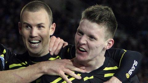 Joe Mason (right) celebrates with Kenny Miller after scoring against Brighton