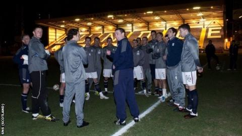 Dundee manager Barry Smith had to tell his players the game was off