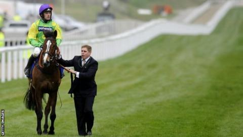 Kauto Star is lead off the course after being pulled up during the Cheltenham Gold Cup in 2012