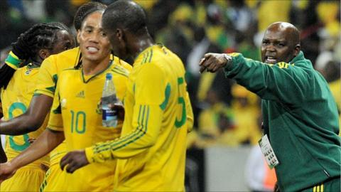South Africa coach Pitso Mosimane (in green) directs his players