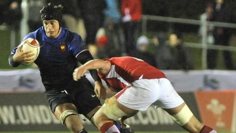 Ieuan Jones tackles France's Julien Kazubek