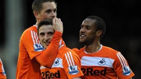 Gylfi Sigurdsson, Joe Allen and Wayne Routledge celebrate Swansea City's win over Fulham