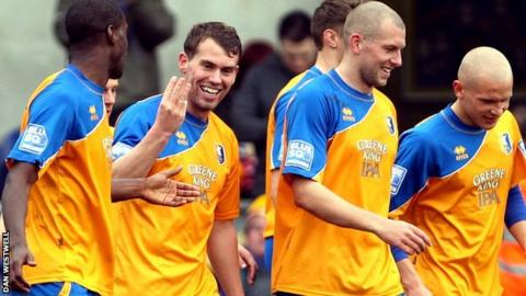 Louis Briscoe celebrates his hat-trick