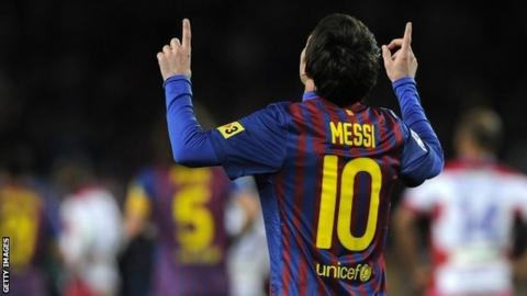 Lionel Messi celebrates after equalling Barcelona's 60-year-old goal-scoring record