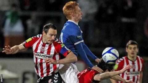 Derry's Barry Molloy challenges Linfield's Robert Garrett in the Brandywell game