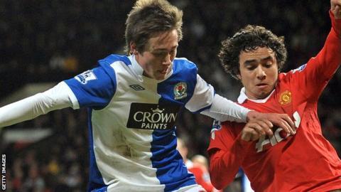 Josh Morris is tackled by Manchester United's Rafael Da Silva