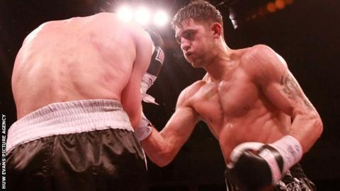 Nathan Cleverly in action against Tommy Karpency