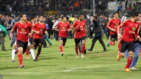 Al-Ahly players flee the pitch in Port Said