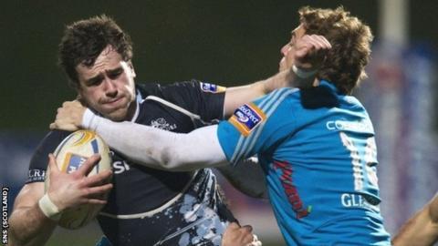 Glasgow's Alex Dunbar is tackled by Giulio Toniolatti